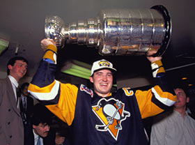 Mario Lemieux celebrating with the Stanley Cup after Game 4 of the 1992 Stanley Cup Final on June 1, 1992