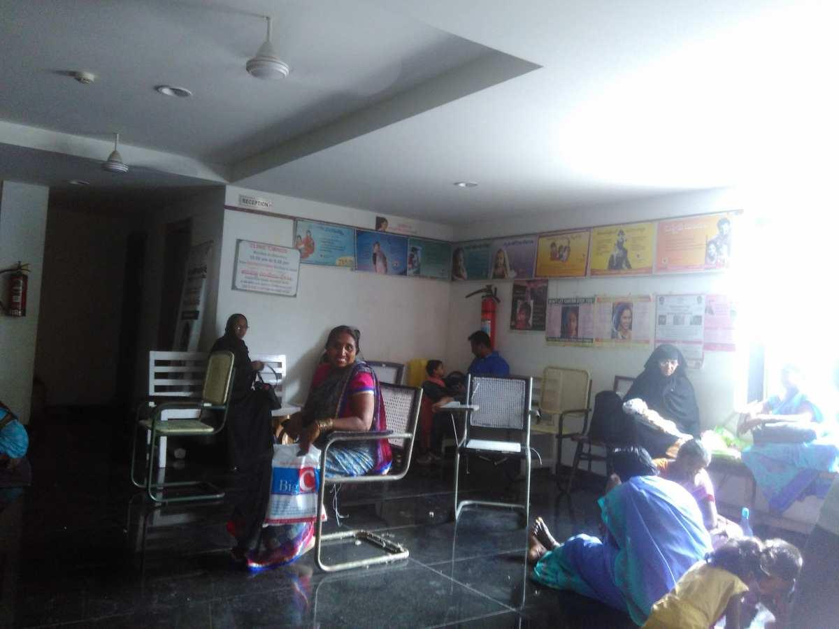 Women sitting outside a clinic
