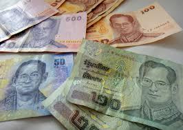 Thaise baht zwalkt ten opzichte van de dollar