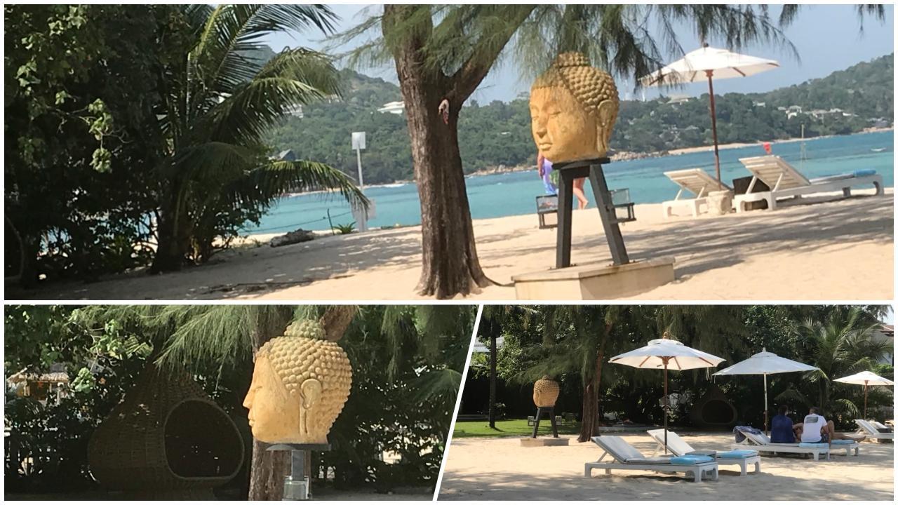 Boeddhabeeld op het strand
