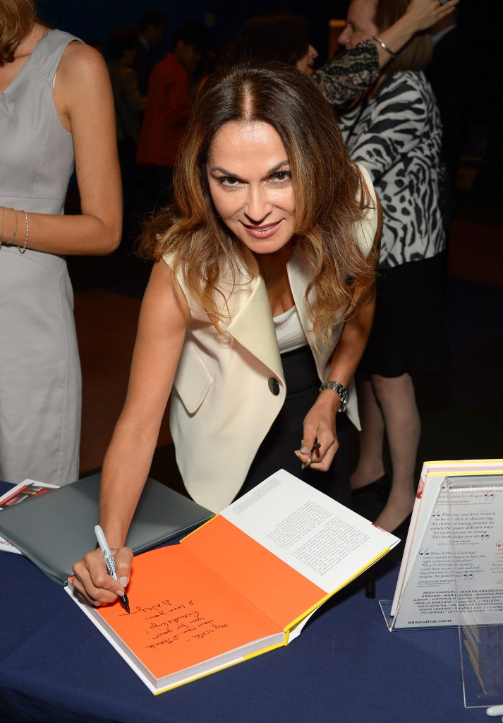Author Angella Nazarian signs a book at Women's Forum for the Economy & Society New York Cocktail at French Institute Alliance Francaise on September 17, 2015 in New York City. (Photo by Andrew Toth/Getty Images for Assouline)