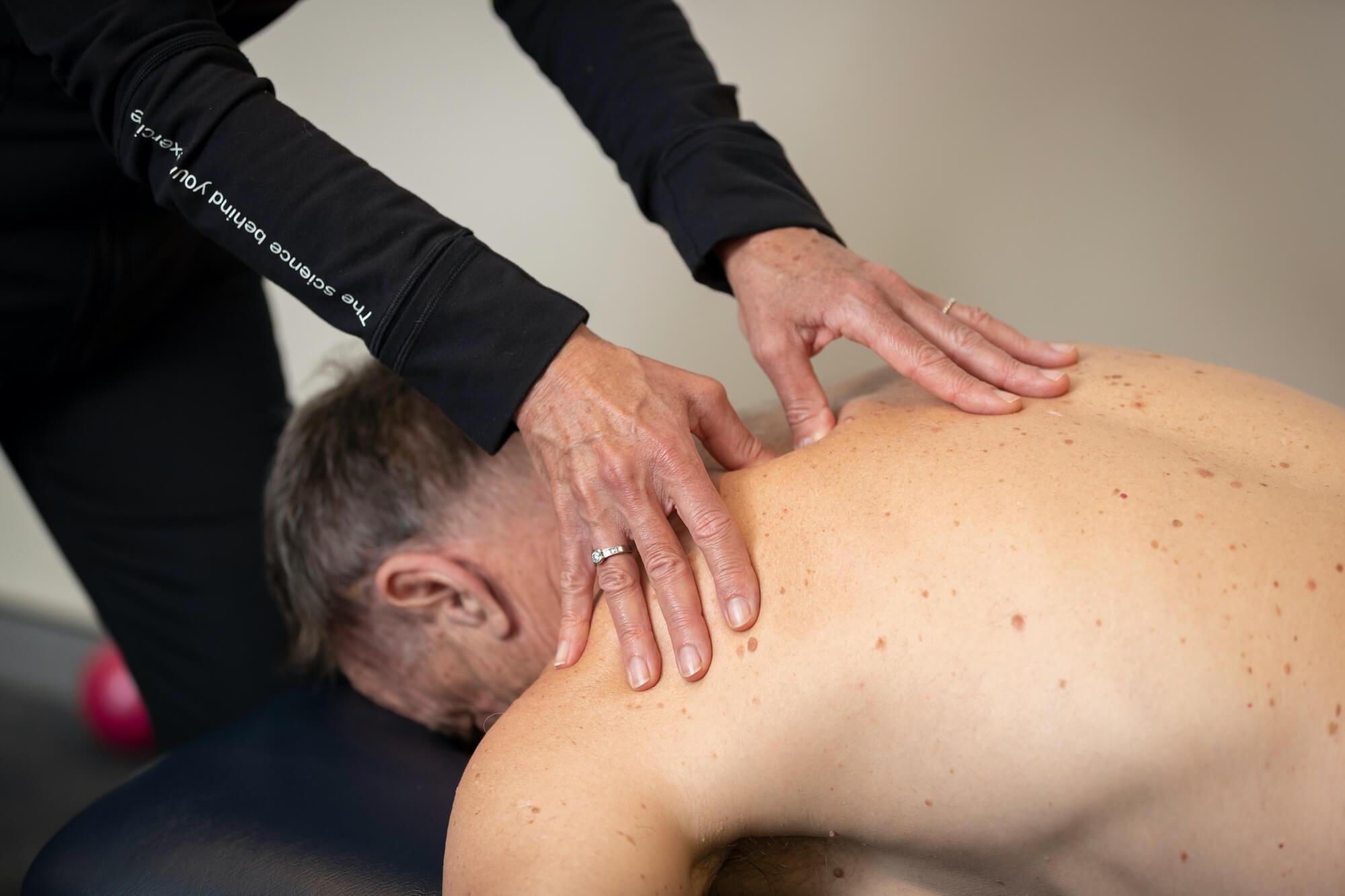 Man receiving upper back physio massage