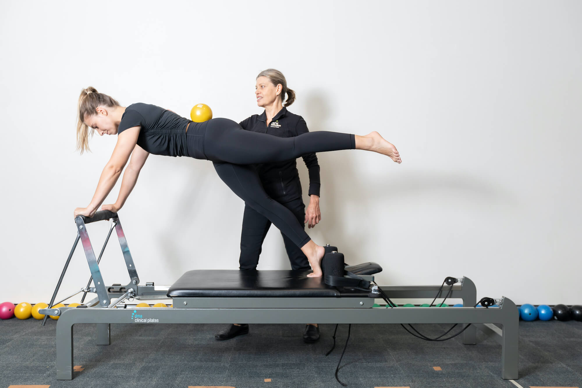 lady using clinical pilates reformer