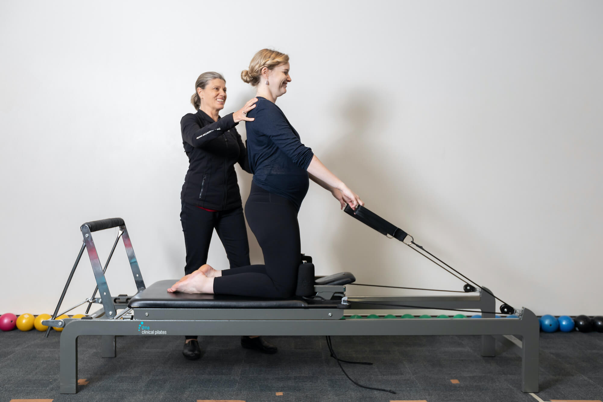lady stretching clinical pilates reformer
