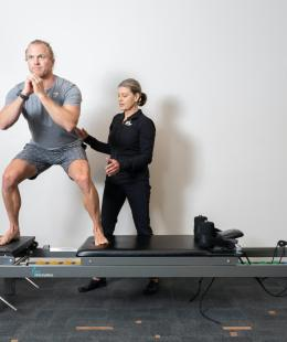 squat exercise on clinical pilates reformer