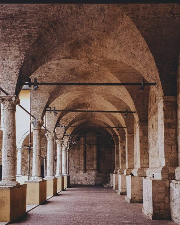 Wander beneath the porticoes
