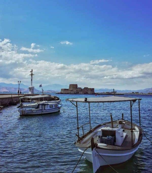 Boats sail across to the Venetian fortress of Bourtzi, Nafplio