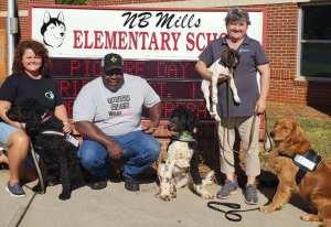 dogs volunteers outside nb mills elementary