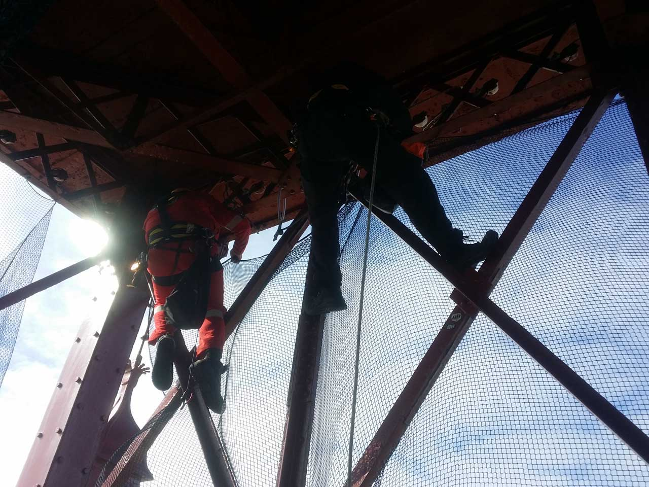 rope access team installing Safety Netting at the top of Blackpool Tower.