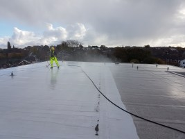 high level steam cleaning roof pressure washing