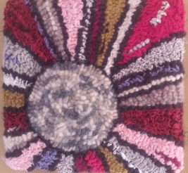 """""""Northern Sun""""; 8""""x8""""; $37.50; wool yarn, upcycled clothing strips, poly and novelty fabric, ribbon"""