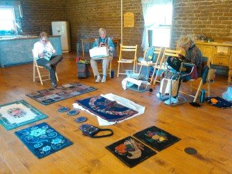 You'll find many of AWAG ladies demonstrating rug hooking at Albuquerque's Biopark the first Tuesday of most every month.