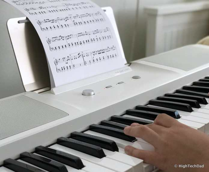 The ONE smartpiano keyboard - use with sheet music too