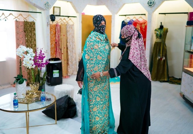 Sabrina Seyf, owner of Sabrina's Bridal, worked with a bride-to-be in her store at Karmel Mall in Minneapolis.GLEN STUBBE - STAR TRIBUNE