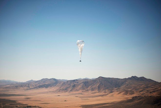 A Loon internet balloon, carrying solar-powered mobile networking equipment over the company's launch site in Winnemucca, Nev. The balloons started delivering internet access to Kenya on Tuesday.Credit...Loon LLC