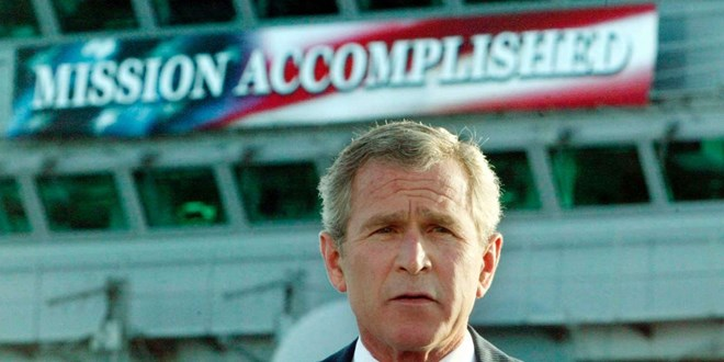 © Larry Downing/Reuters Bush delivering a speech to crew aboard the aircraft carrier USS Abraham Lincoln, as the carrier steamed toward San Diego, California on May 1, 2003. Larry Downing/Reuters