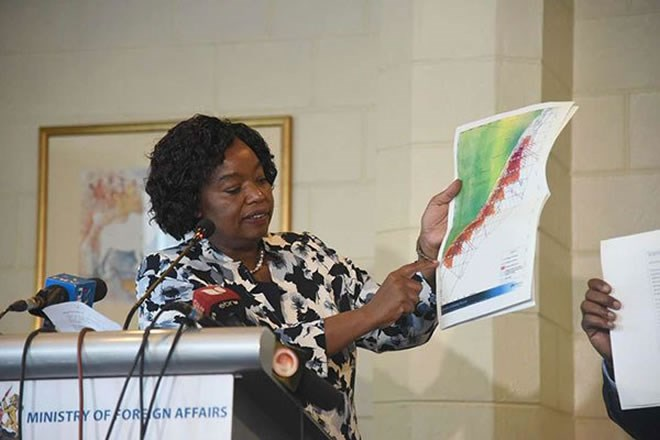 Foreign Affairs Cabinet Secretary Monica Juma displays a map indicating that the oil blocks under contention with Somalia are in Kenya's territory, during a press conference at Intercontinental hotel in Nairobi on February 21, 2019. PHOTO | EVANS HABIL | NATION MEDIA GROUP