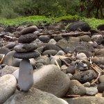 Dozens of rock cairns adorn the edge of Hanakapi'ai Beach
