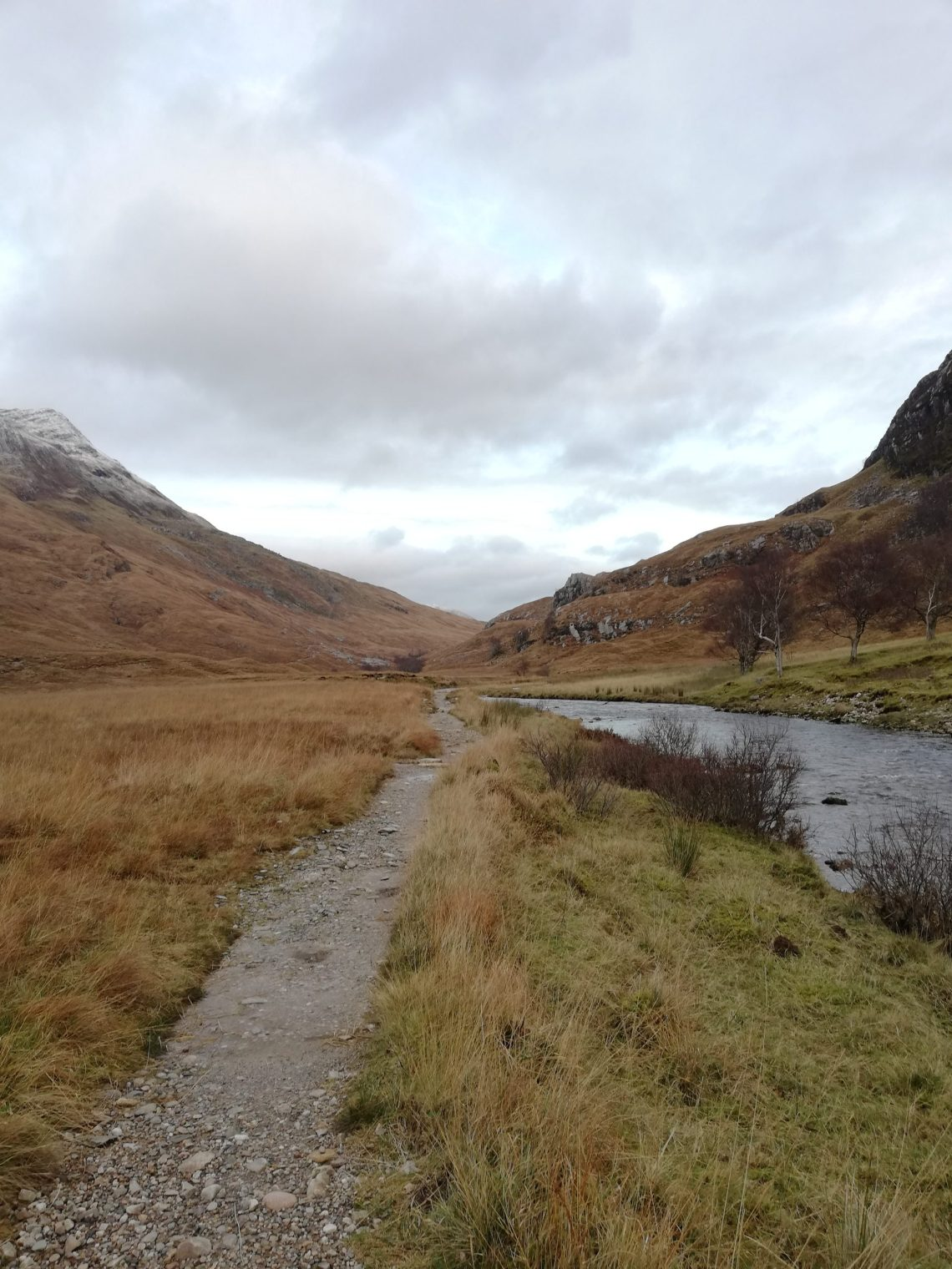 Navigation practice in Glen Nevis with the footpath running along the river down the glen framed by hillsides on both sides.