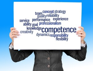 a professional holding up a sign representing competence, reliability, knowledge, expertise, service and knowledge
