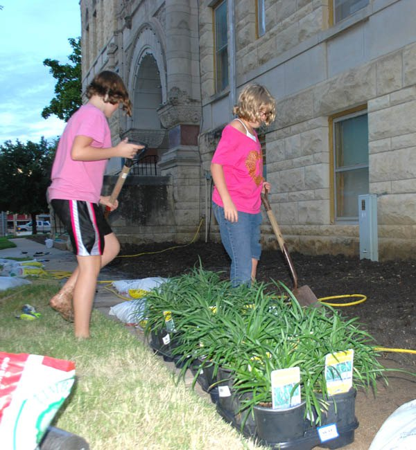 Nicole Sanders and Sarah Spencer prepare the soil for planting during a Sept. 13 evening work session.
