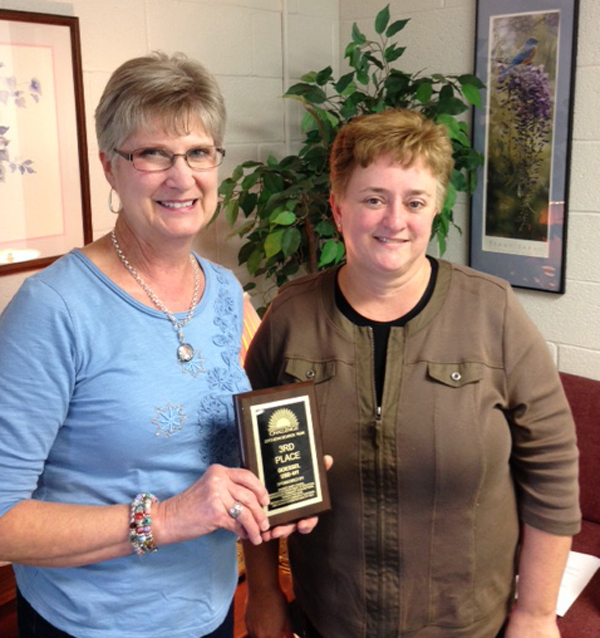 Sandra Duerksen (left), director of the food program at the grade school, and Barbara Banman, director of the food program at the high school, hold the plaque USD 411 received through the Kansas School Breakfast Challenge. ?We appreciate their conscientious and diligent efforts to meet our students needs,? said Superintendent John Fast. Courtesy photo USD 411