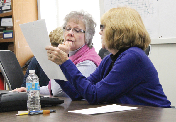 Eileen Sieger checks signals with Anita Brookens during the recounting of ballots for the 1st District county commission seat. Joining them on the three-person team was Ruth Lange. The recount found that Lori Lalouette-Crawford defeated Craig Dodd by three votes.  Free Press file photo