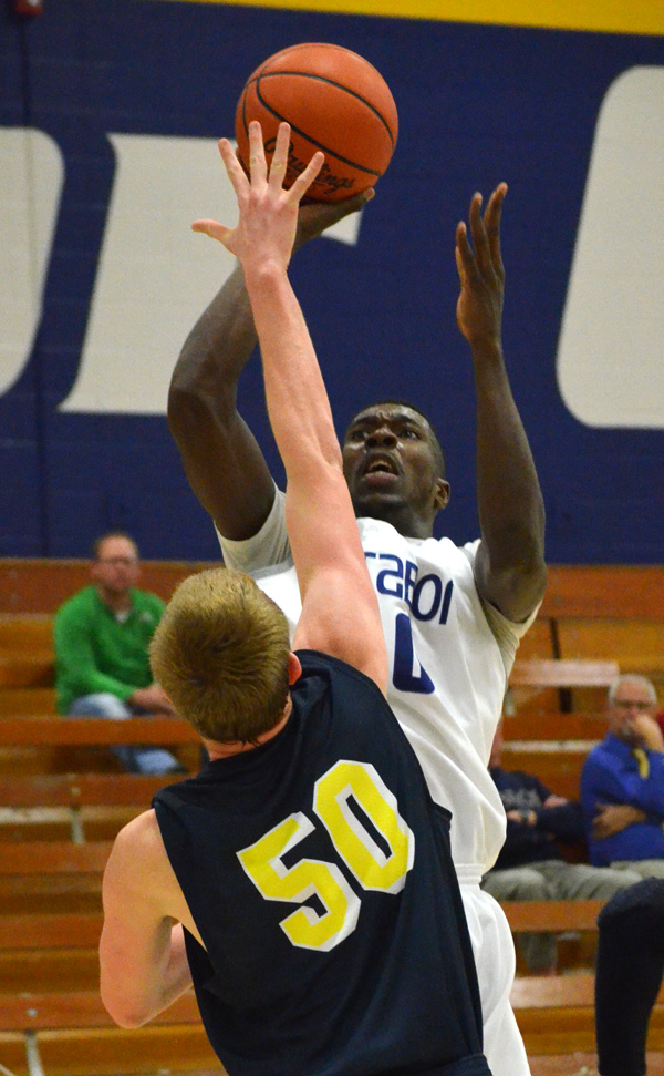 Andrew Thomas makes a basket to give Tabor a 70-52 lead over the University of Saint Mary. Thomas was the Bluejays? leading scorer with 21 points in Tabor?s 99-82 win.