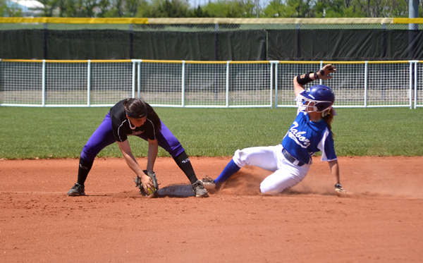 Kellyn Holt slides safely to second after hitting a double in the bottom of the second inning against Southwestern Thursday. Holt was 3-for-4 at-bat in Tabor?s 4-0 win.  Janae Rempel / Free Press
