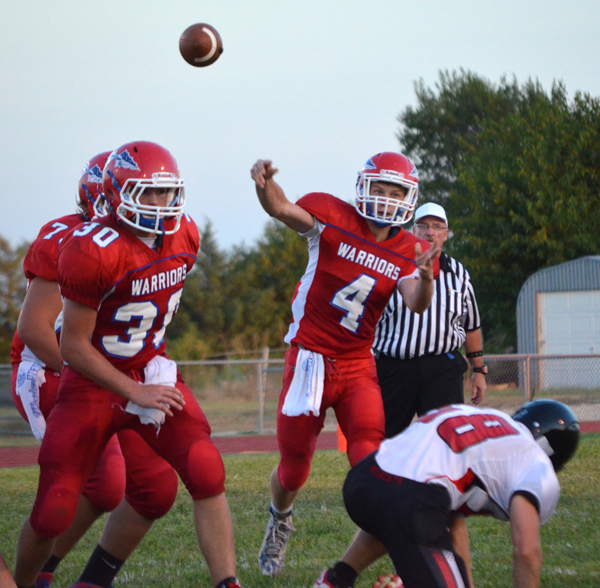 Jack Schneider passes the ball to Peyton Heidebrecht for a 24-yard gain during the second quarter against Moundridge Friday. The drive ended with a touchdown that gave Marion a 16-0 lead.