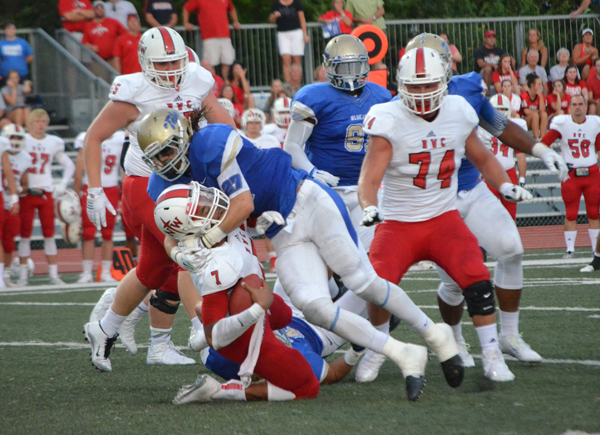 Dylan Delk sacks Northwestern quarterback Jonathan Kodama for a 3-yard loss during the second quarter Saturday. In a defensive battle, Delk was Tabor?s leader with 14 total tackles, including eight solo tackles. The Bluejays lost the game, 9-7.