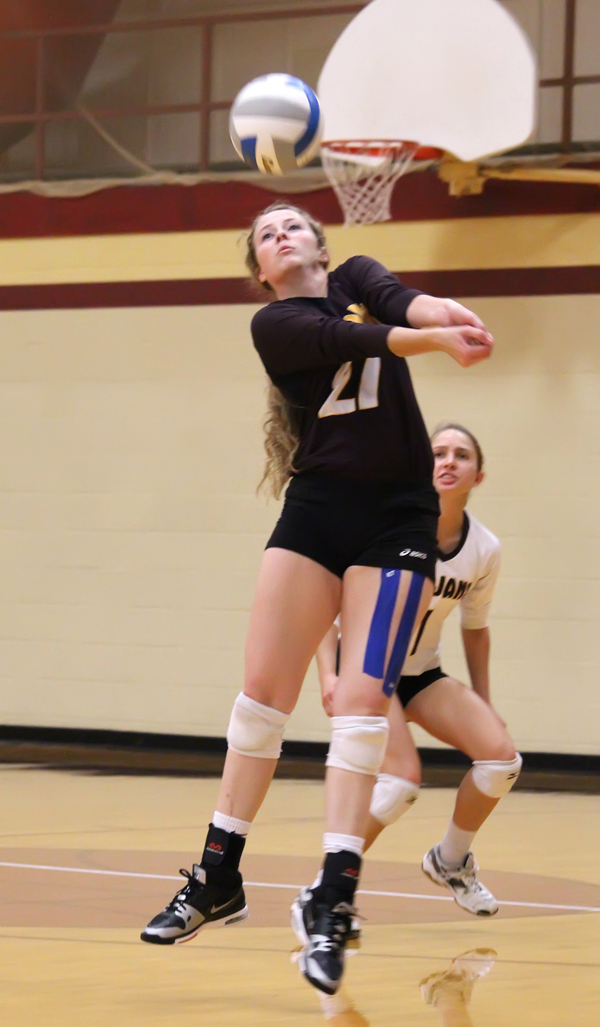 Shannon Heiser passes the ball during Hillsboro?s two-set win over Larned Tuesday. The Trojans went on to defeat Sterling to maintain a share of first place in the Central Kansas League.