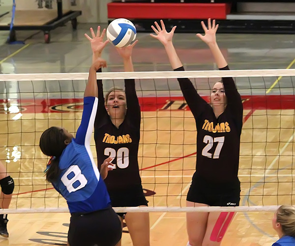 Don Ratzlaff / Free Press<p>Hillsboro?s Callie blocks a Goddard attack during pool play at McPherson. The Trojans finished second at the 10-team invitational.