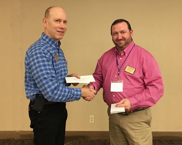 "Jeff Gillespie, president of the Kansas Association of Agricultural Educators, presents the ""K-ACTE Teacher of the Year Award"" to Mark Meyer, Marion High School ag teachers"