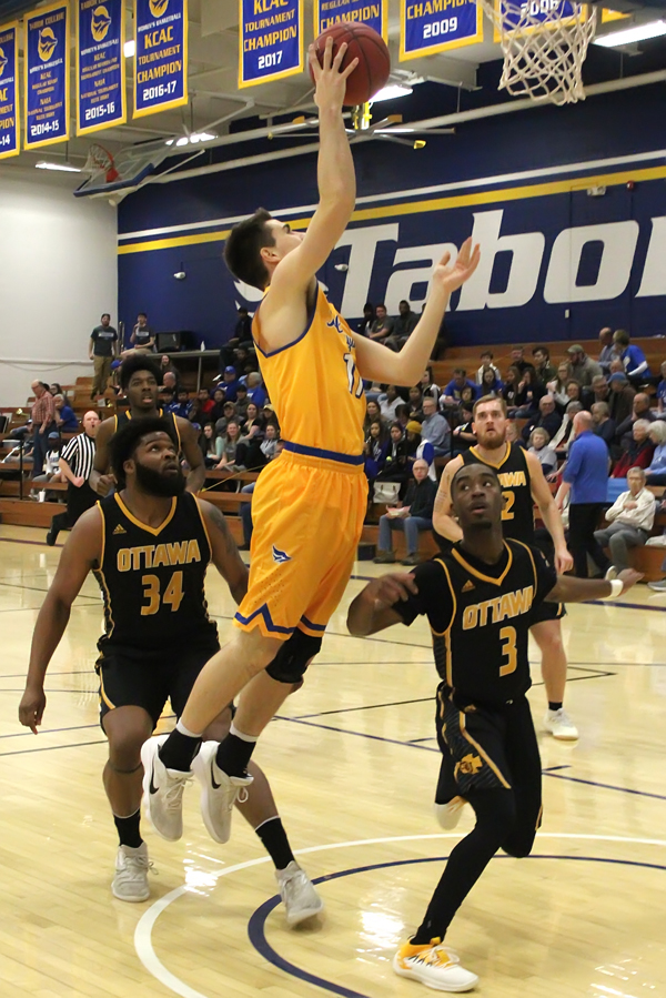 Gaven Schumann soars for two points early in the Bluejays' game against Ottawa on Saturday. He contributed 10 points in the 100-79 victory.
