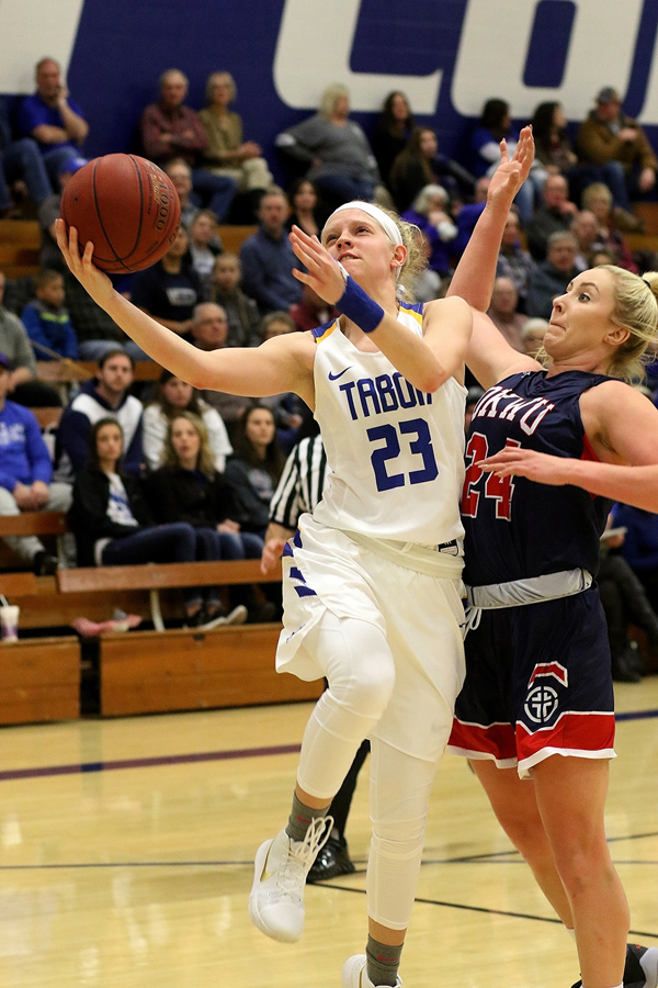Morgan Ediger is fouled by Mary Hutchins as she drives to the basket after a steal. Ediger, the team's scoring leader, returned to action Wednesday for the Sterling College victory after being sideline with a wrist injury since Jan. 3.