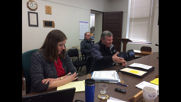 Marion County Emergency Management Director Randy Frank makes his case for a burn ban at the March 12 county commission meeting. Seated behind him is Peabody Fire Chief Mark Penner.