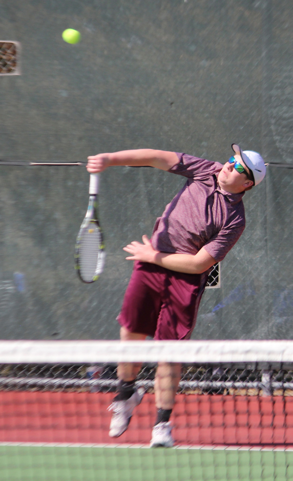 James Isaac serves to Jacob Peters of Chapman in No. 1 singles at the Hillsboro Invitational Thursday at the Sports Complex. Isaac, a senior, lost this match but finished fourth in the top bracket.