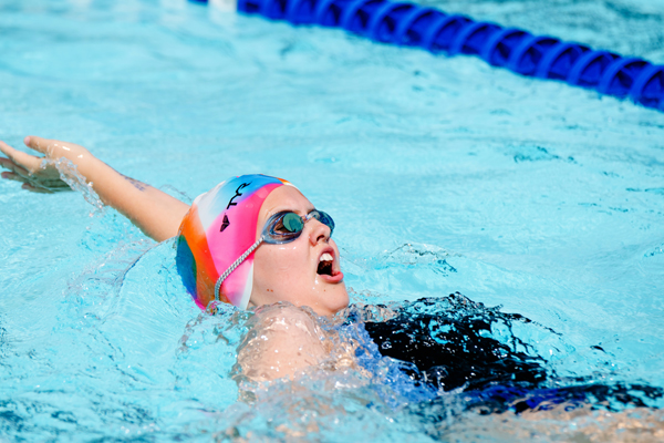 Mallory Hein competing in the 50-yard backstroke in the age 13-14 division. Karrie Rathbone