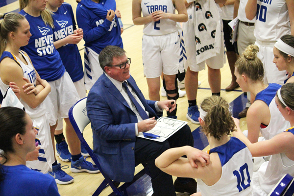 Shawn Reed, Tabor College head coach for women's basketball, leads a timeout discussion during the 2018 season. Free Press file photo