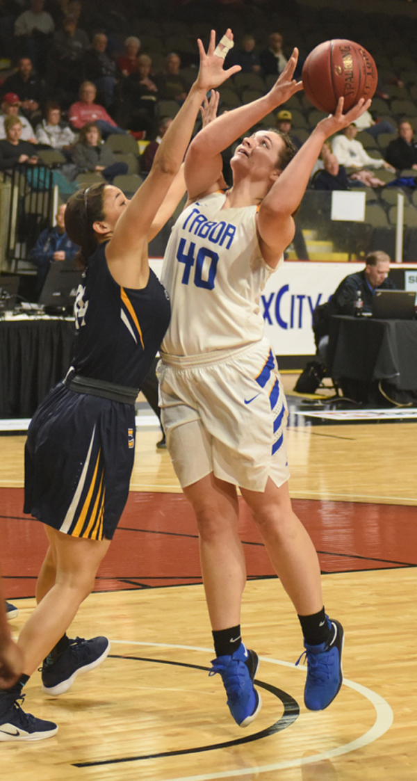 Kristyn Wedel moves in for a basket at the game against Corban University on Thursday. Wedel was the point leader for the game with 14 points and five rebounds. Michael Klaassen / Tabor College