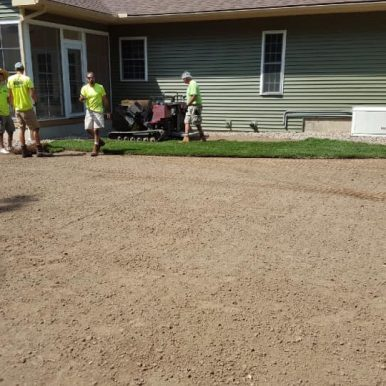 Hillside Seasonal Services employees prepping for a rolled lawn installation