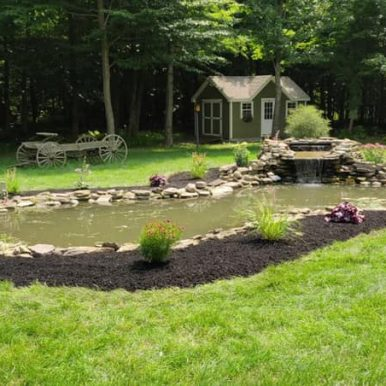 Landscaping work around a pond by Hillside Seasonal Services
