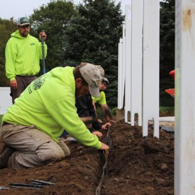 picture of Hillside Seasonal Services employees working on a fence