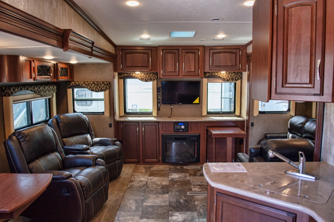 """33', 3 Slides, 33"""" TV, Fireplace,    Electric Awning w/LED Lights,    Queen Bed, Rear Entertainment Center,  Incredible amount of Space!   MSRP $54,141      Special Price $38,900"""