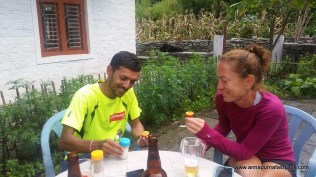 Sudeep demonstrates how to eat a 'Tree Tomotoe' at our favorite lodge in Ghasa - the Eagle's Nest