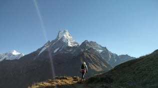 Emma leading the trail. Macchapuchre in the backdrop.