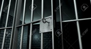 14582730-a-closeup-of-the-lock-of-a-brick-jail-cell-with-iron-bars-and-a-key-in-the-locking-mechanism-with-th-stock-photo