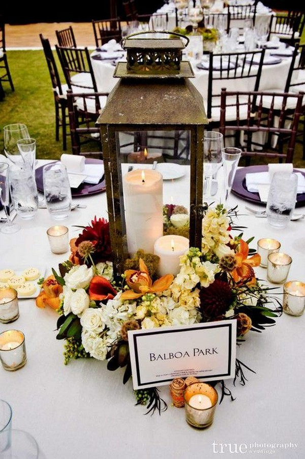 floral centerpiece with a lantern and a flameless candle inside