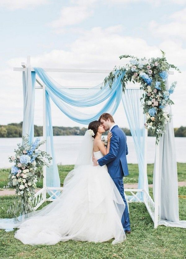 light blue and greenery wedding backdrop for spring wedding